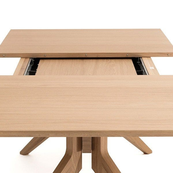 Leaves are easily stored inside the felt lined compartment under the table.