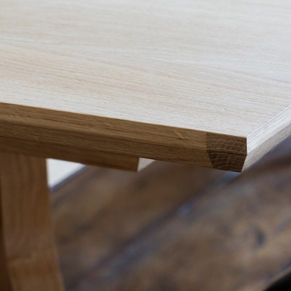 Detailed woodwork with mitred edges portrays excellent furniture craft.