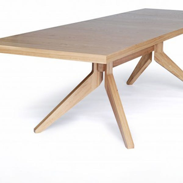 Tabletop well supported by beautifully made legs creating an elegant silhouette.