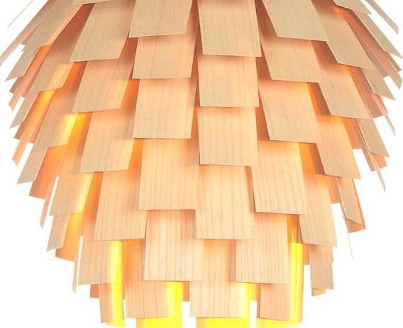 Slatted scales, skilfully shaped and intricately layered diffuse the light