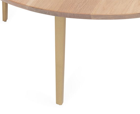 Powder coated steel legs complement Crawford's oak table top.