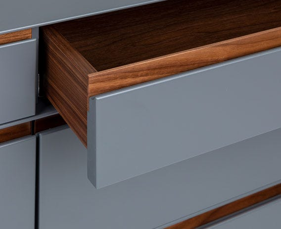 The pairing of deep walnut tones with a matt painted grey finish gives each piece a cool and contemporary timeless appeal.