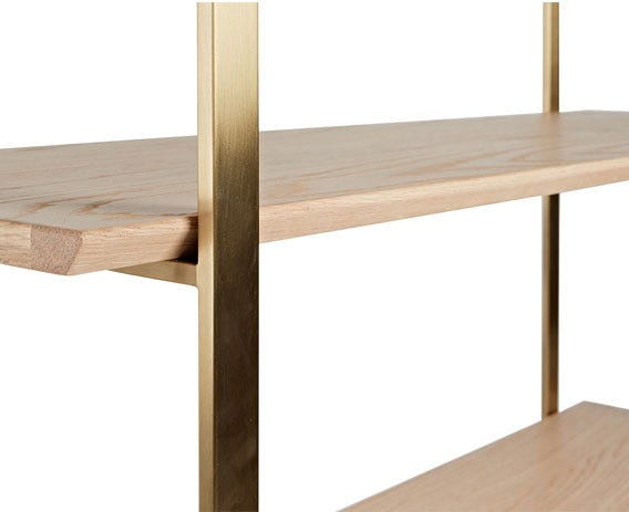 A brass plated frame and  legs and complement Crawford's oak shelves.