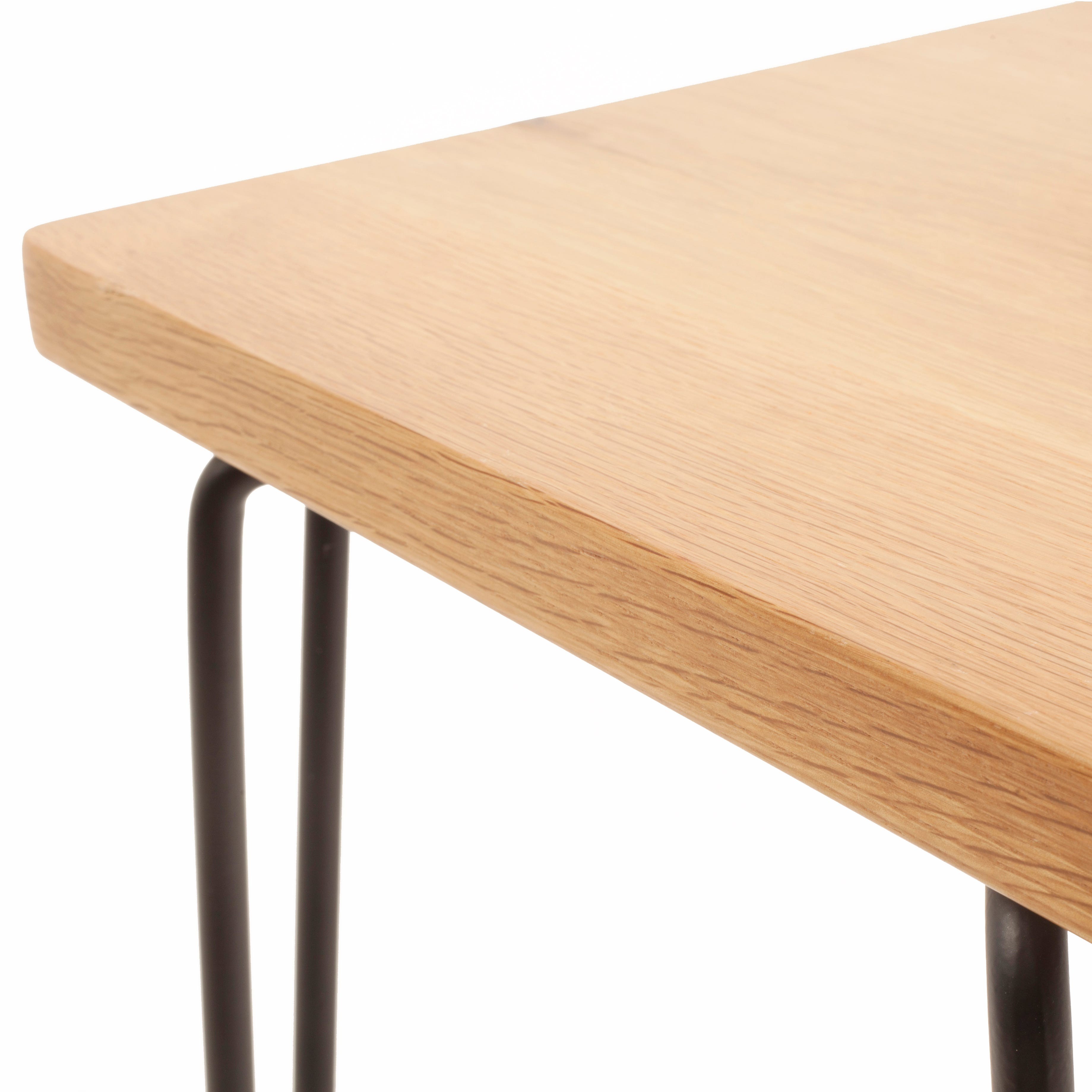 An agile design from Rob Scarlett that can be used as a dining seat, dressing stool or side table.