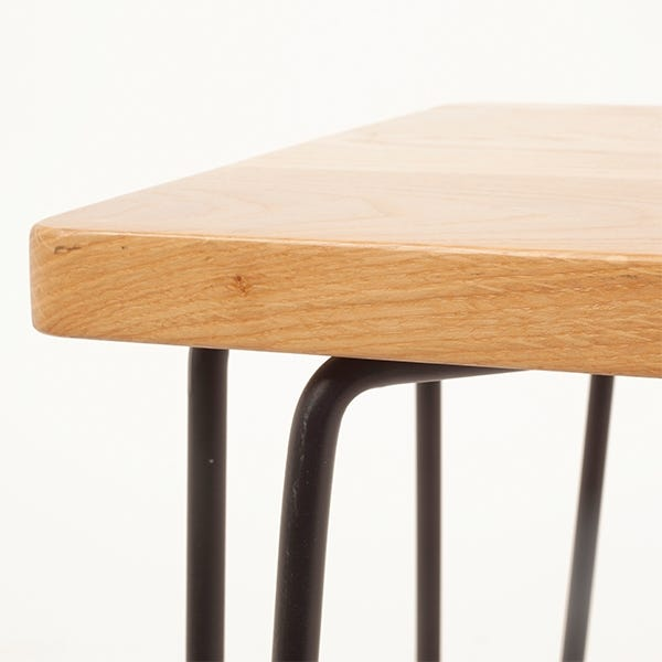 Industrial style powder coated steel frame contrasts against the wooden seat for a Mid-century Scandinavian feel.