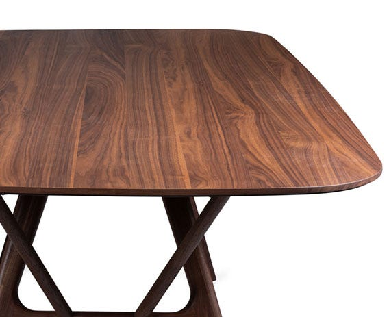 The solid American walnut table top is paired with a unique walnut base.