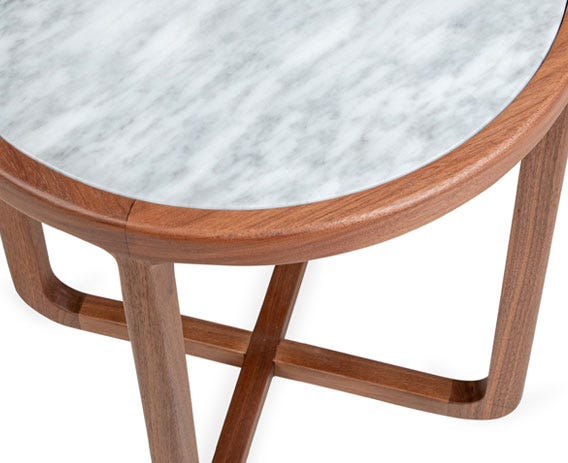 The neatly radiused edges give the side table an elegant contemporary look.