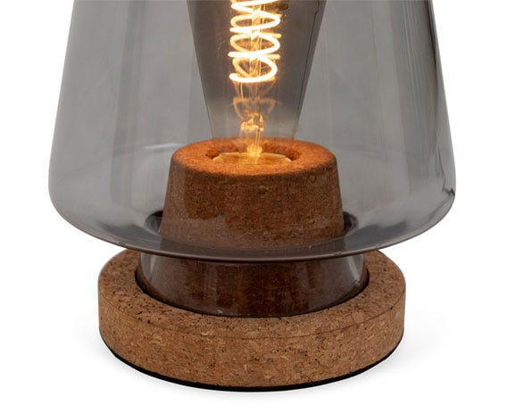 The eco-friendly cork base is contrasted with a smoked glass cover.