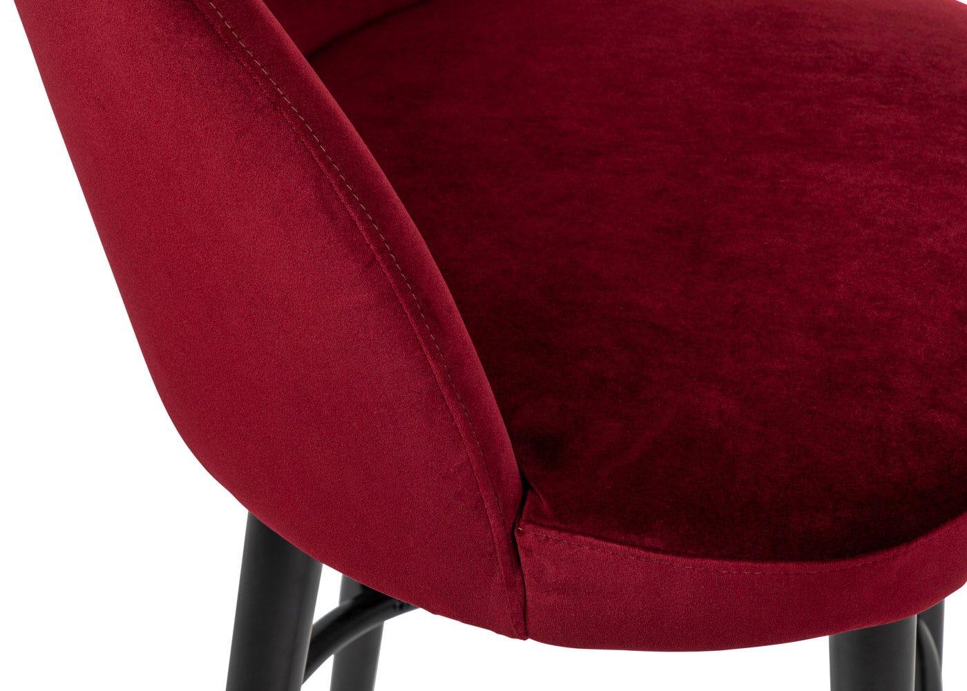 As shown: plush velvet burgundy seat.
