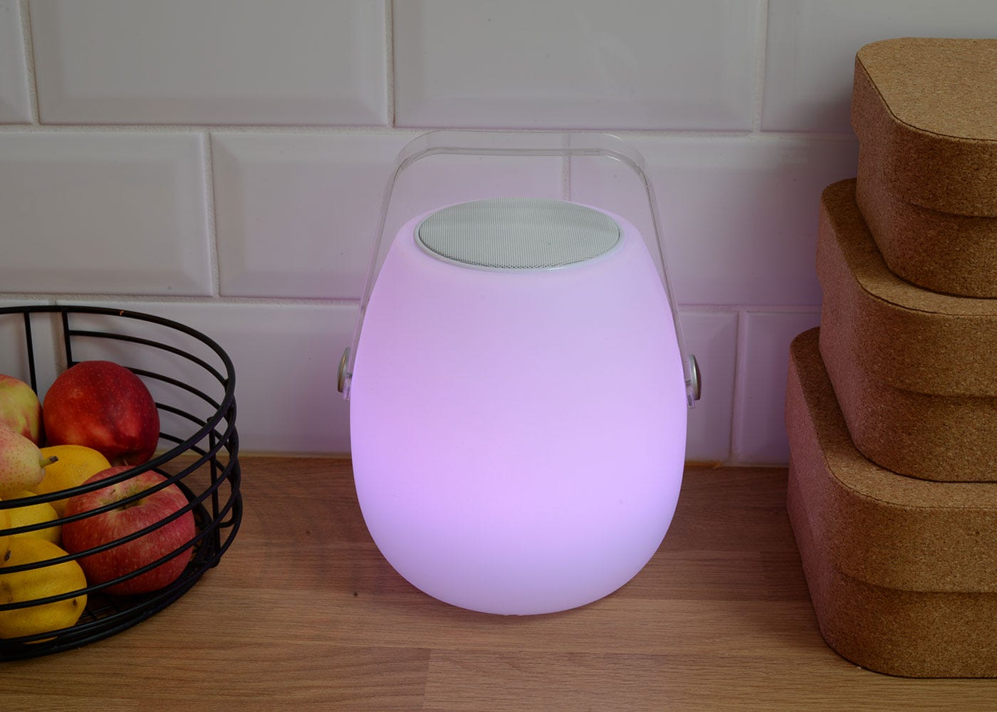 As shown: Ava portable speaker with the pink option on.