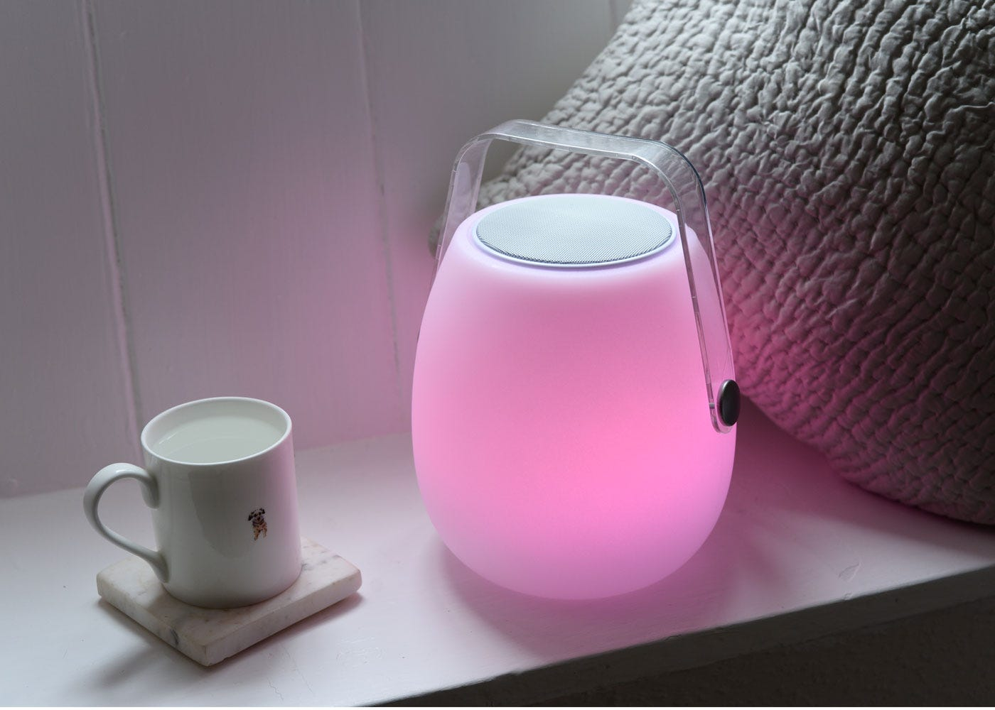 As shown: Ava portable speaker with the pink option on (brighter intensity).