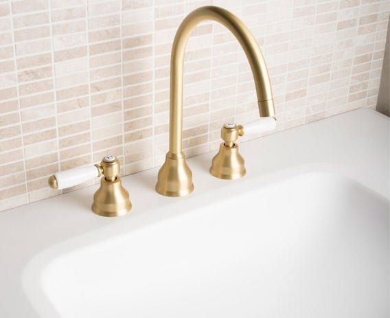 Elegantly curving spout looks graceful when combined with a traditionally styled washbasin