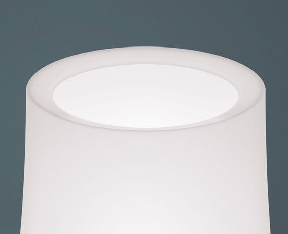 The lampshade filters light giving a warm feeling glow.
