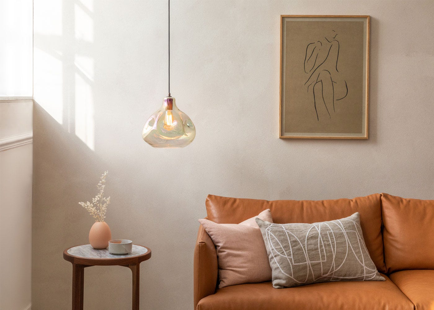 Bolha pendant amber finish, Matera leather sofa, anais marble side table.