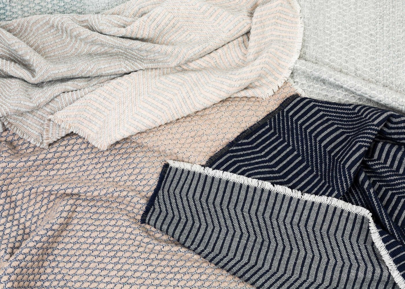 The Furrow and Larker throws by The Bristol Weaving Mill are all made with blends of soft wool