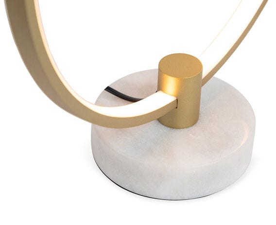 An infinite LED illuminated ring is discreetly concealed behind a gold ring.