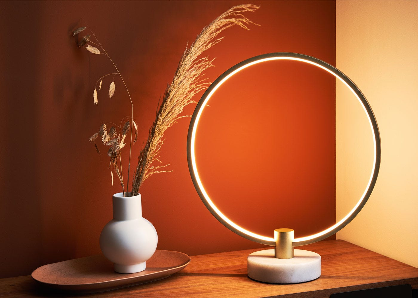 As shown: Circa LED table lamp satin gold - On.