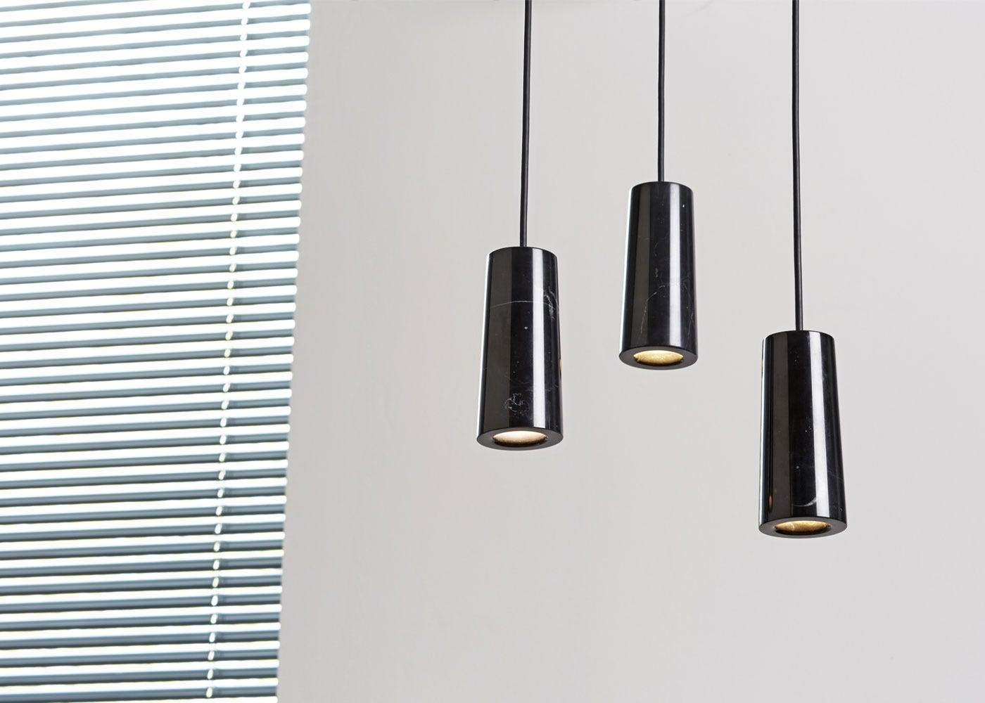 As Shown: Core Three Pendant Light Cluster in Nero Marquina Marble - on.