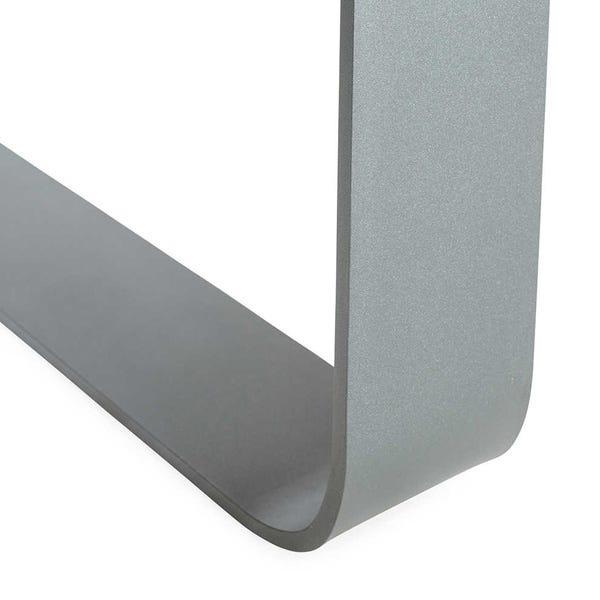 Curved metal legs contrast against rustic table top