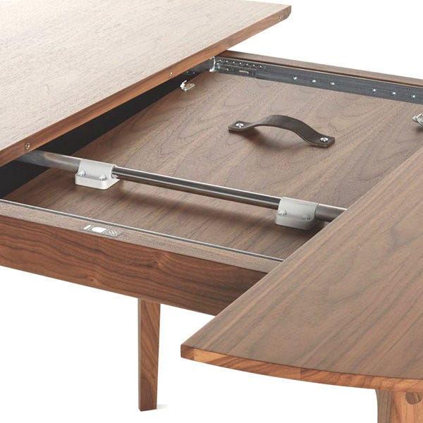 butterfly leaf mechanism simply pull one end of the table to simultaneously open both halves and pull the handle on the concealed leaf