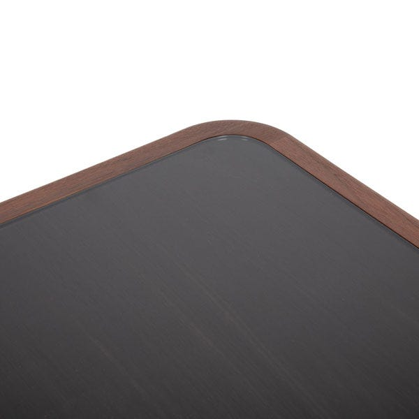 The large square black smoked glass top sits in a walnut frame.