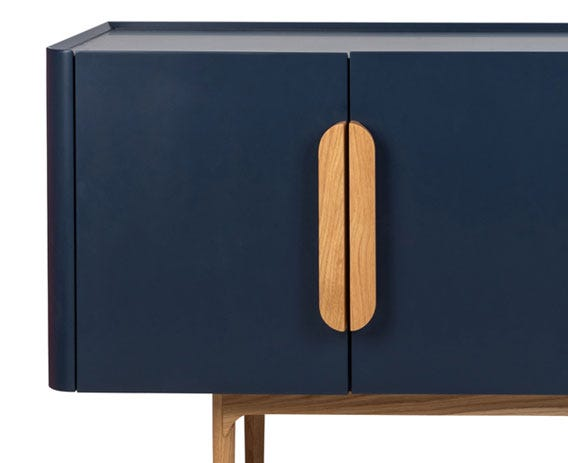 Soft edged handles which handles join together on the front of the sideboard.