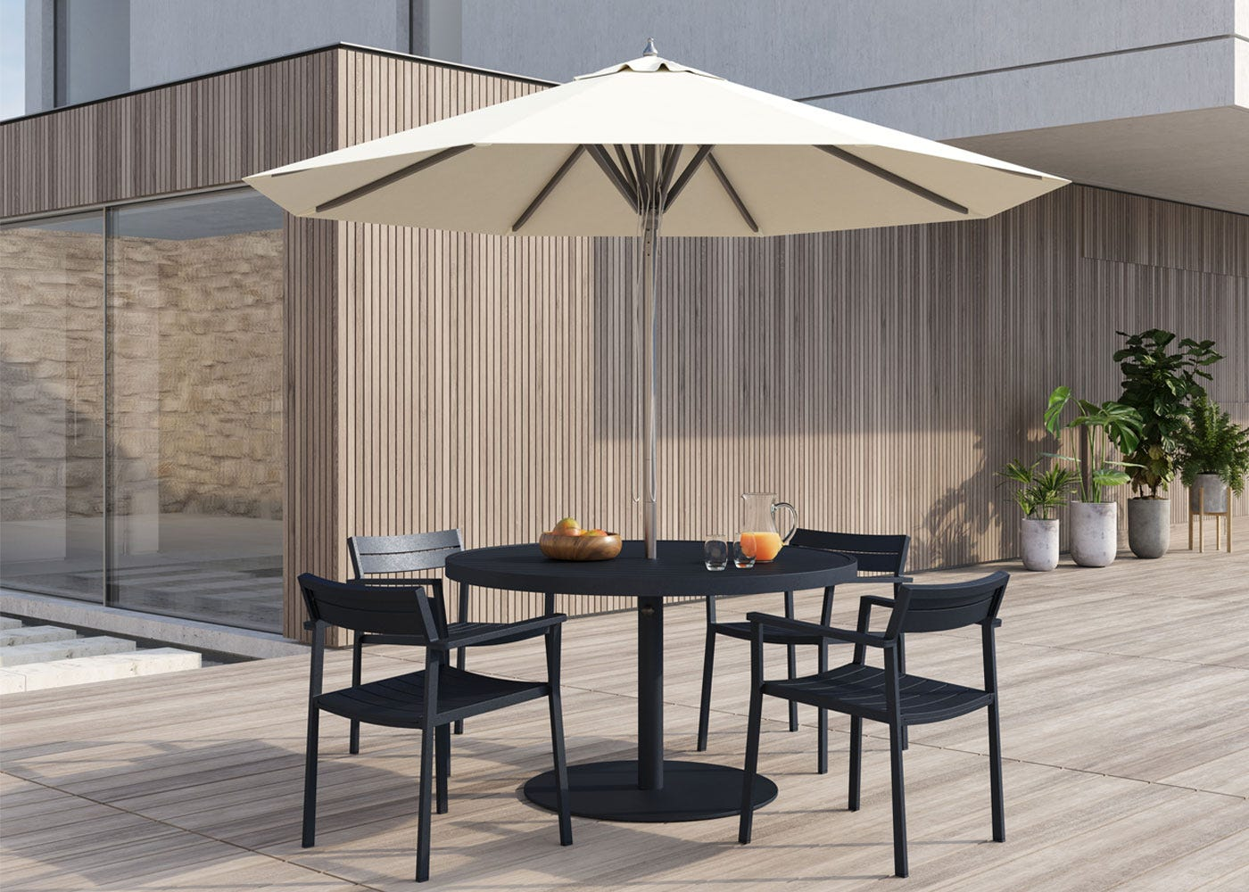 EOS Circular Outdoor Dining Table - Black with matching chairs.
