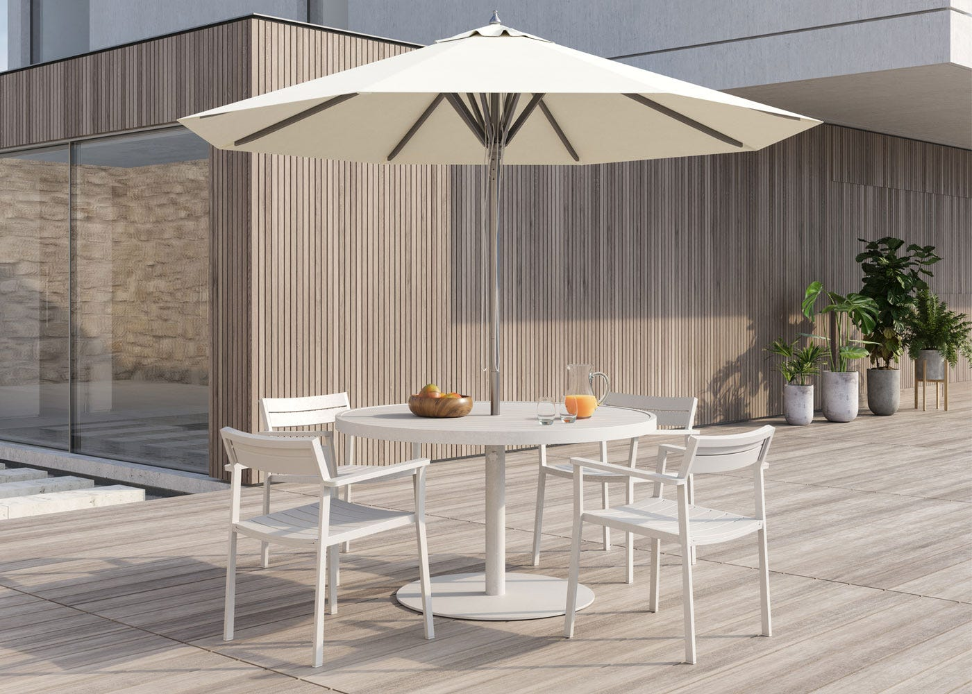 EOS Circular Outdoor Dining Table - White with matching chairs.