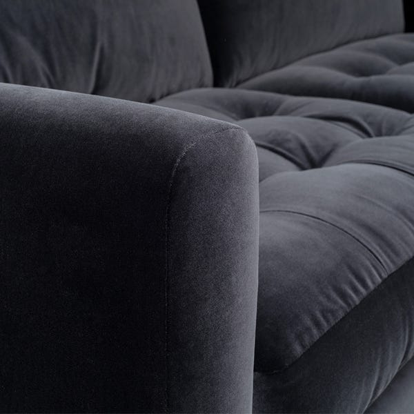 Soft rolled arms compliments the mid-century design