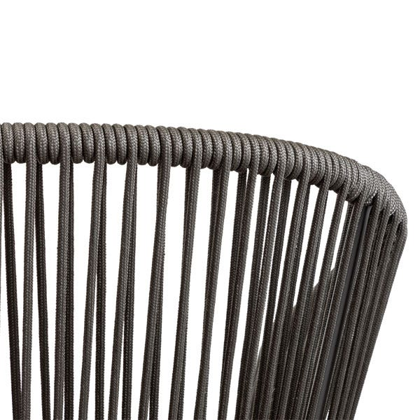 The curved woven backrest creates a luxurious lounging experience.