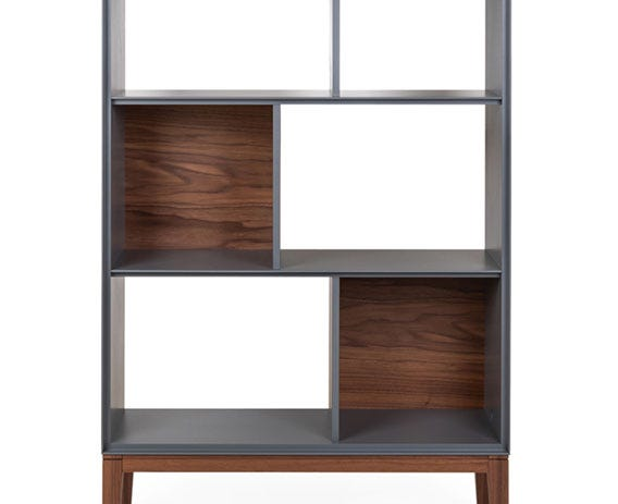 Perfect for showcasing objects or books the Lars bookcase offers a stylish asymmetric design, with 8 storage areas, 3 closed with a walnut veneer panel.