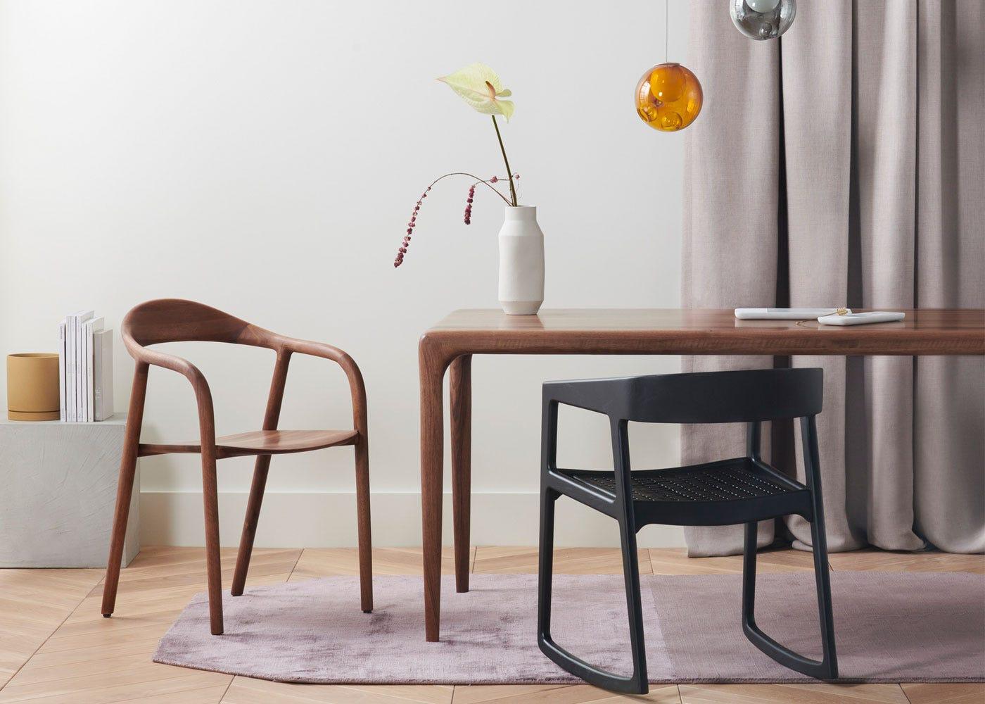 As Shown: Latus dining table, Neva armchair - both in walnut finish.