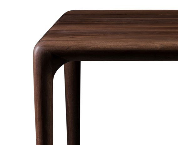 Uninterrupted design, with the  table top flowing seamlessly into the tables legs.
