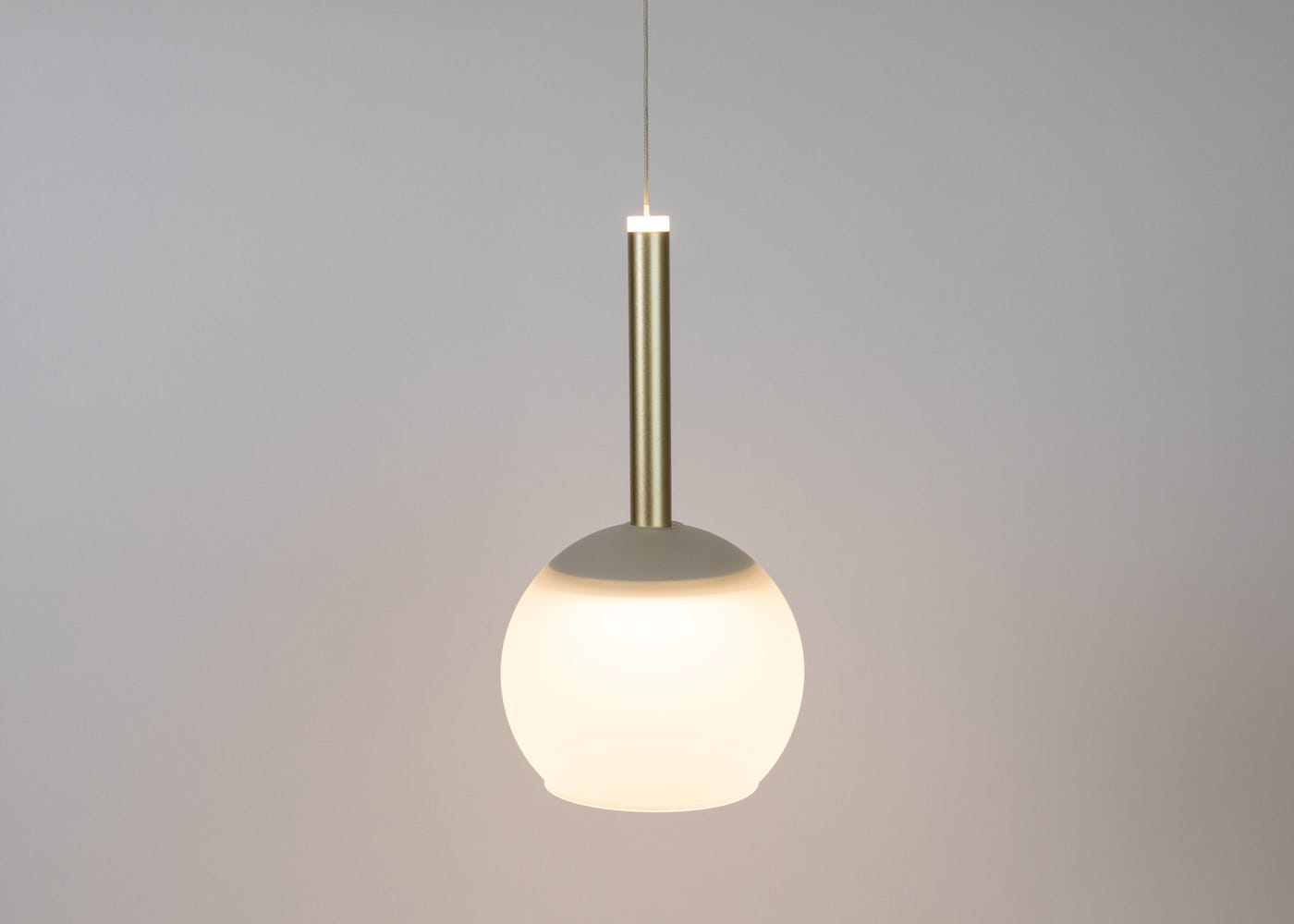 Frosted glass shade with disc long LED pendant in gold on (please note the pendant is sold separately).