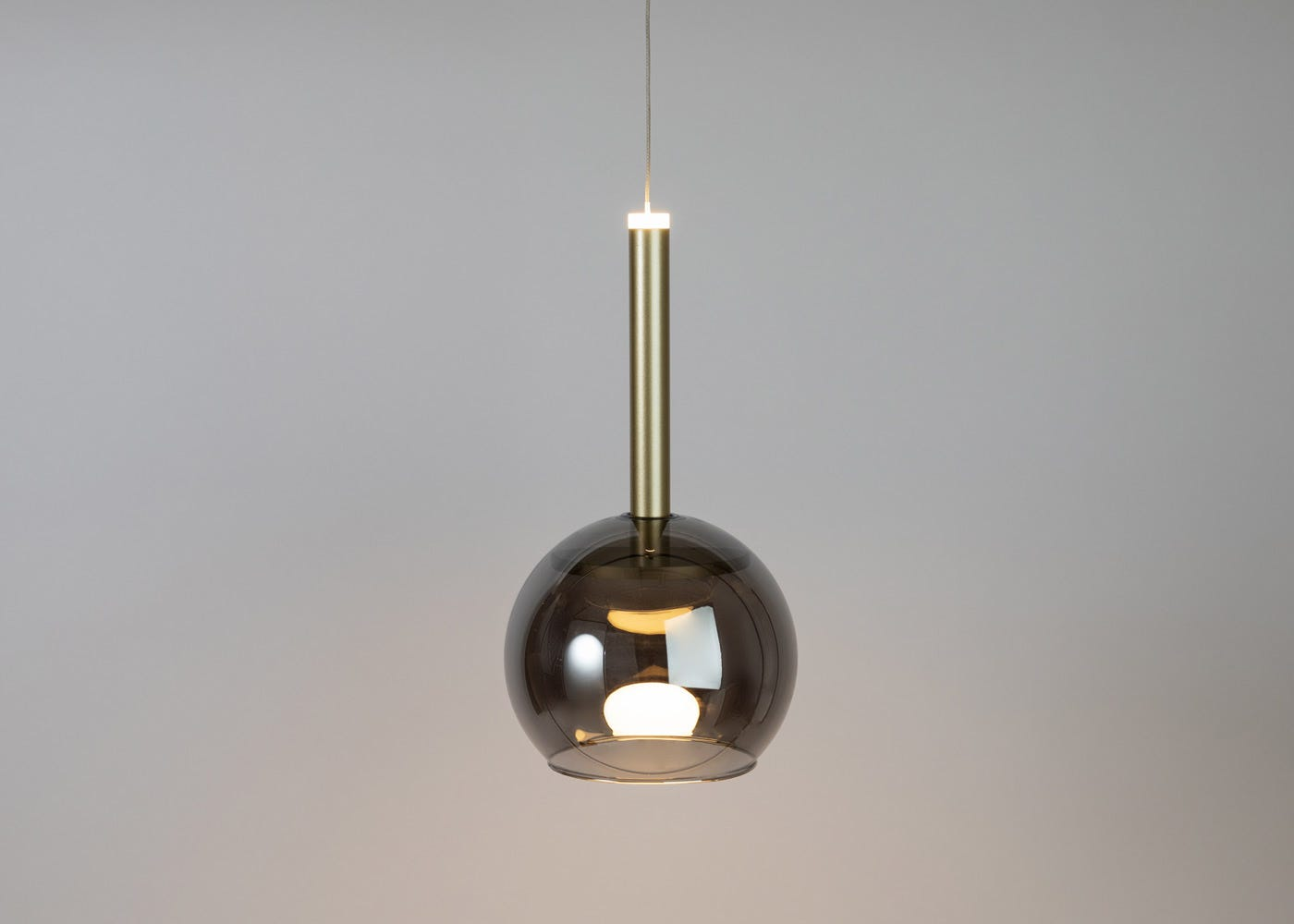 Smocked glass shade with disc long LED pendant in gold on (please note the pendant is sold separately).