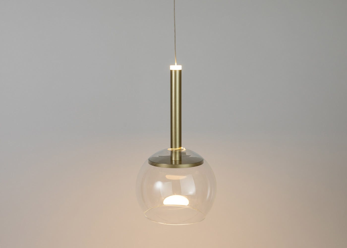 Clear glass shade with disc long LED pendant in gold on (please note the pendant is sold separately).