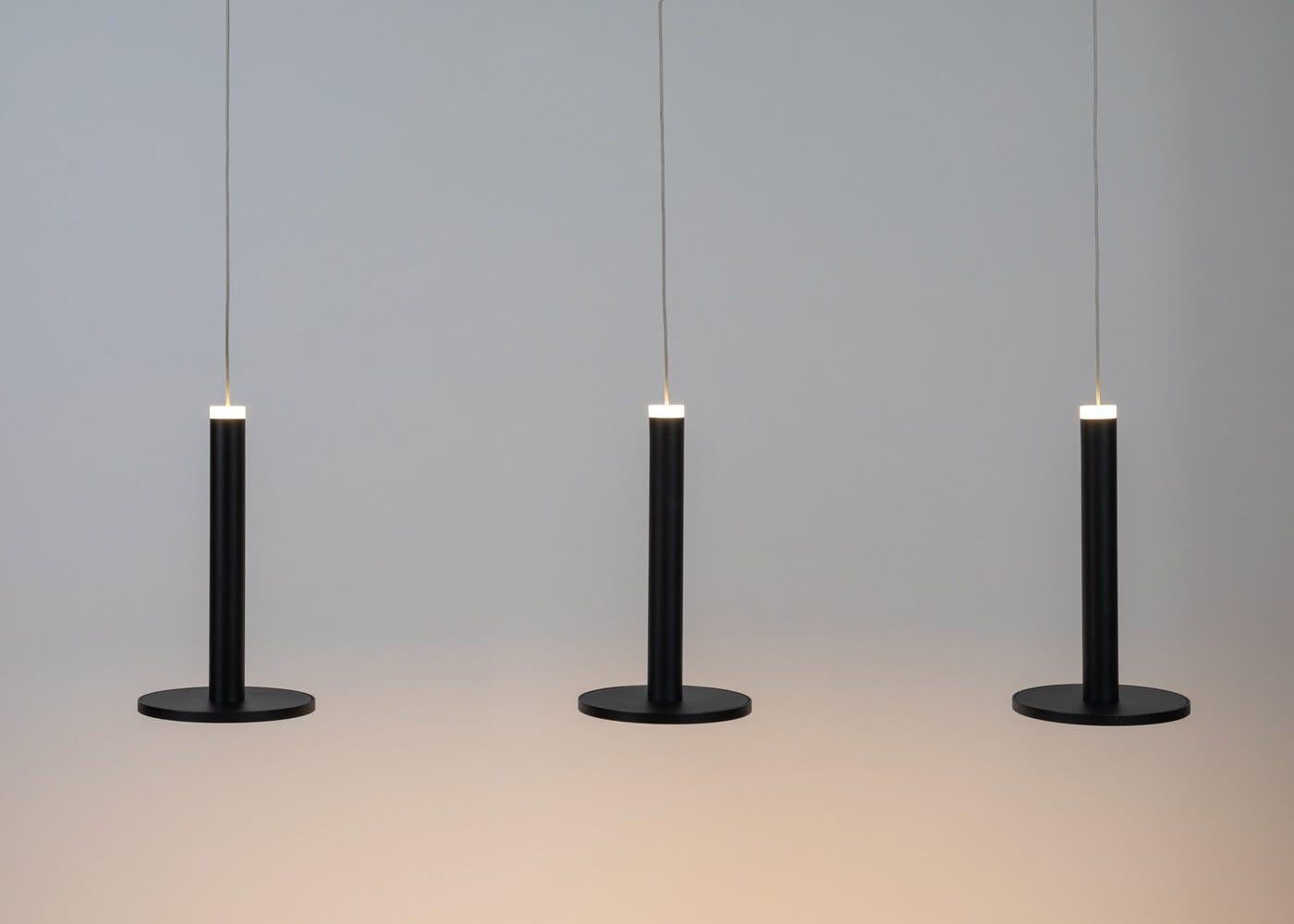 Disc 3 long LED pendant in black - On.