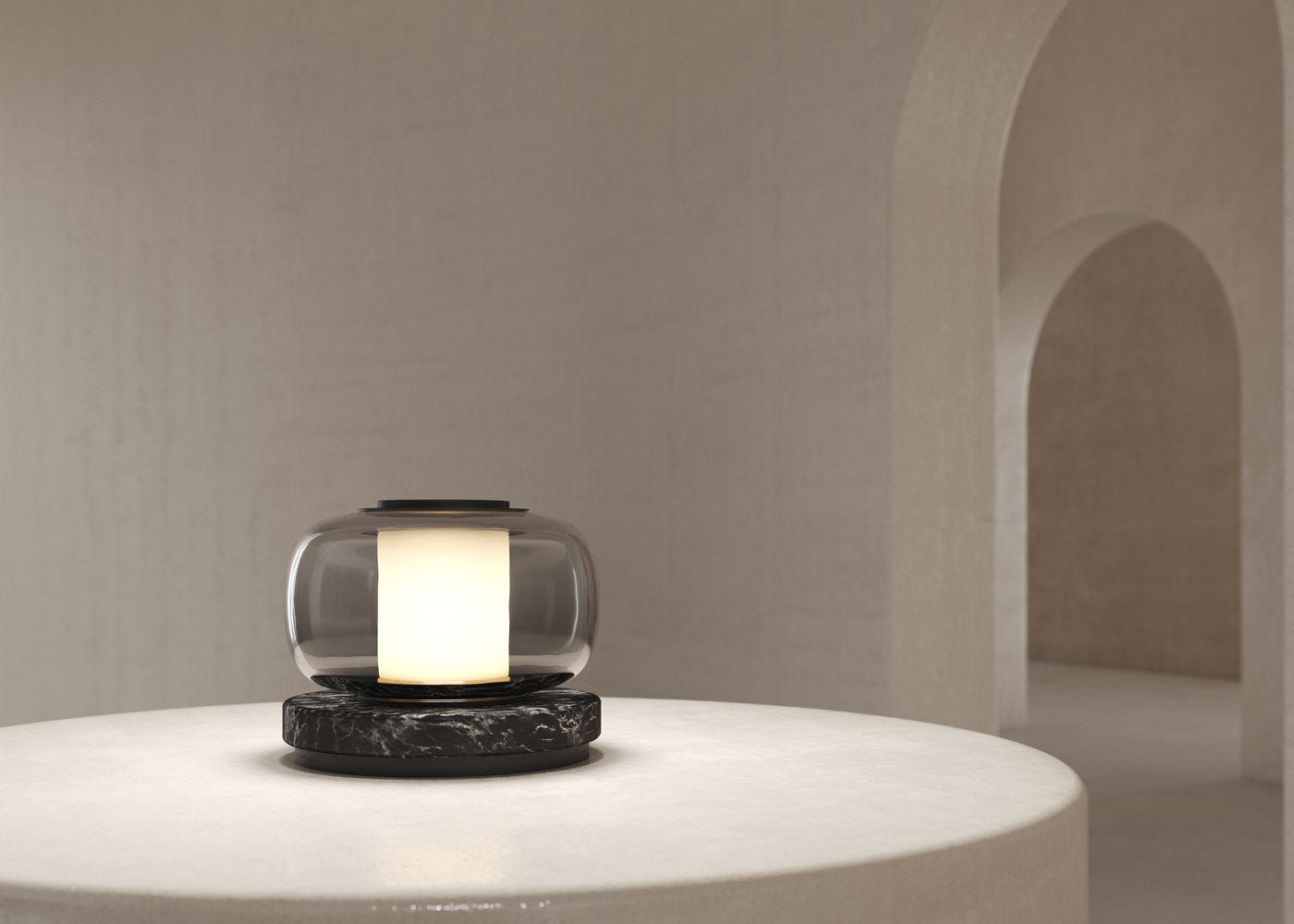 As shown: Luna table lamp in black - on.
