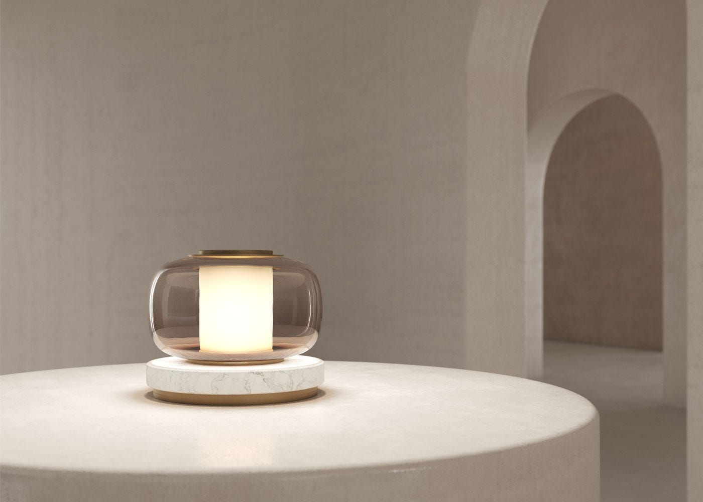 As shown: Luna table lamp in brass - on.