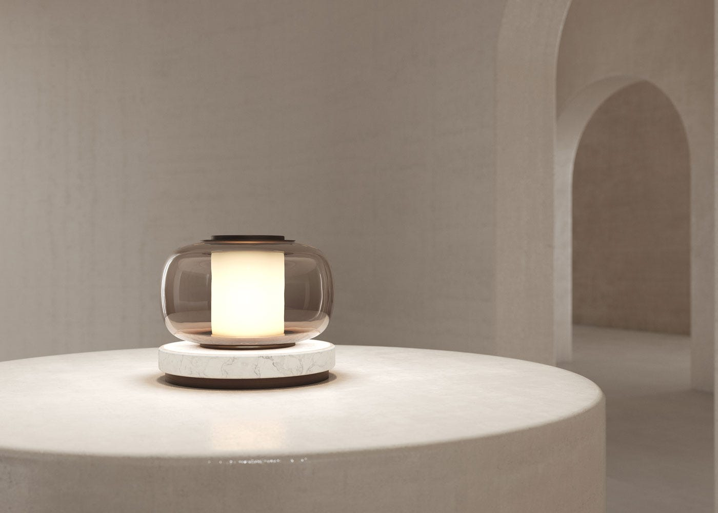 As shown: Luna table lamp in bronze - on.