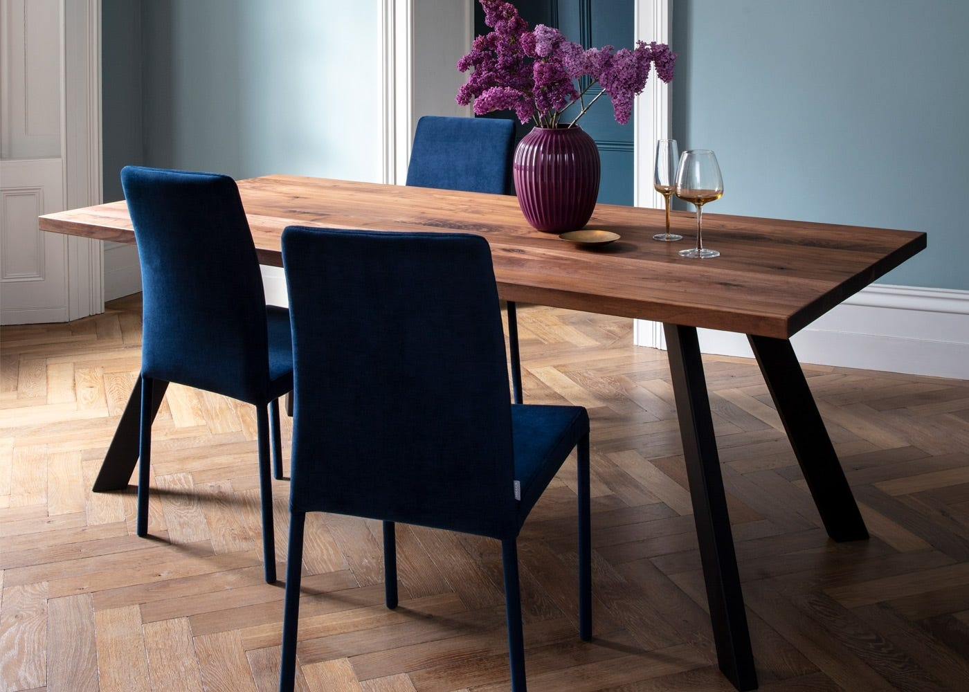 Image shows Madrid dining table in walnut with Bronte chairs and Hammershoi vase plum