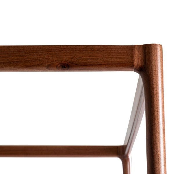 A walnut frame which creates a modern take on a traditional 4 poster bed.