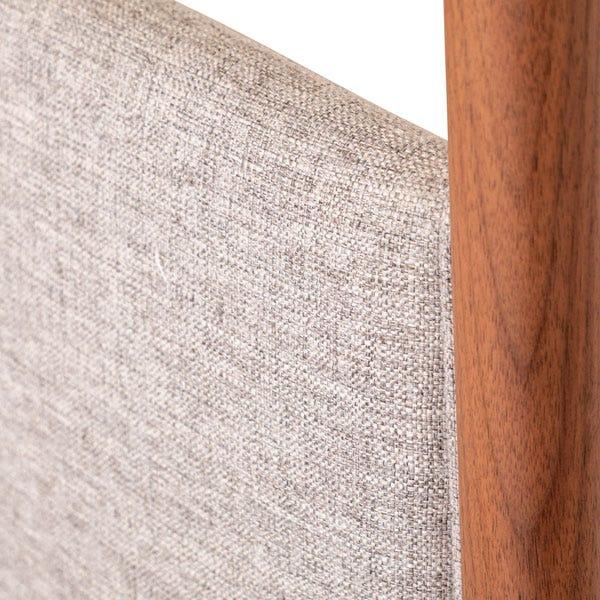 Upholstered grey fabric headboard.