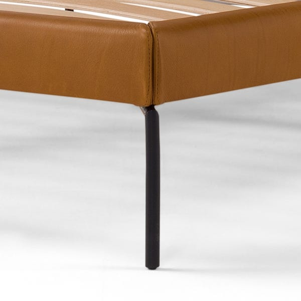 The clean, thin metal legs give the sleek silhouette and small footprint