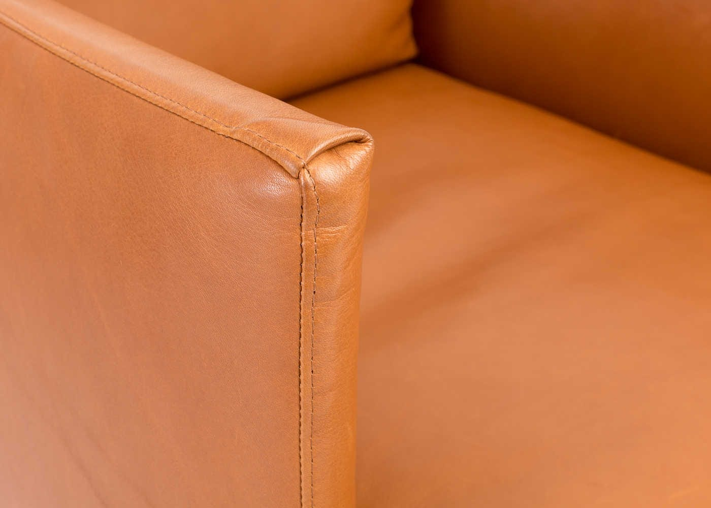 Matera Armchair in Daino Leather Treacle with Black Feet