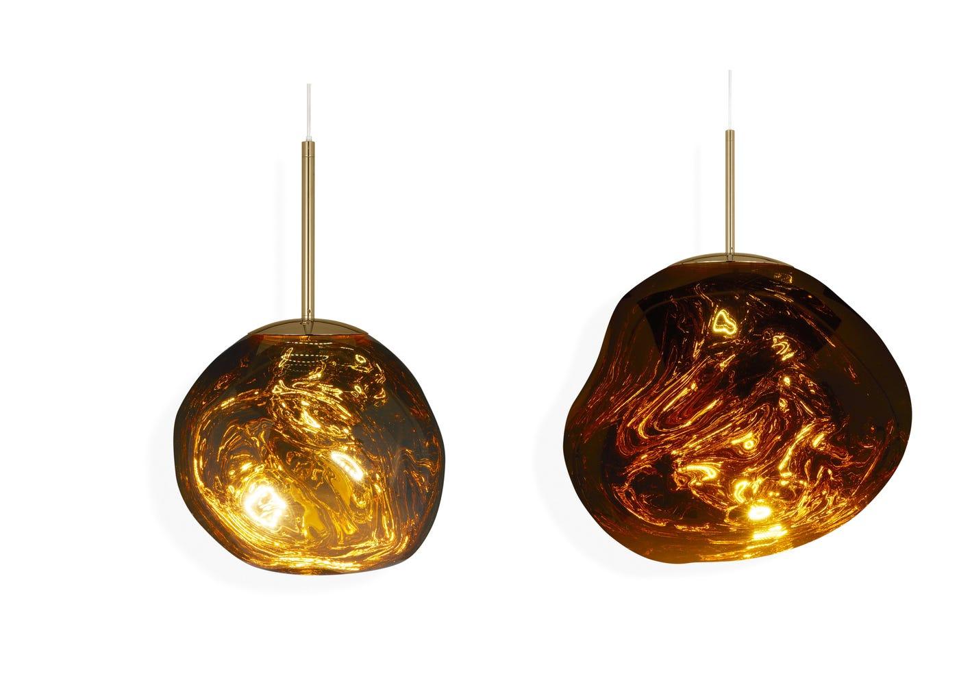 From left to right: Gold mini LED light on, Gold standard LED light on