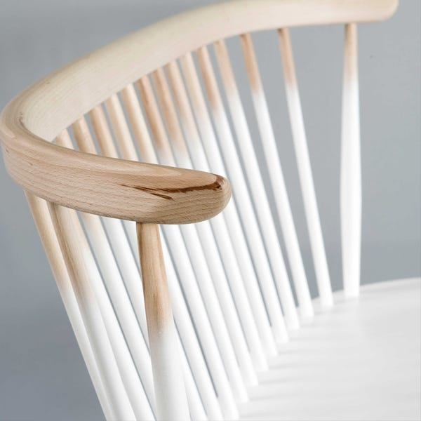 A colour fade adds a dash of the contemporary to the seat, combining colour and natural wood.