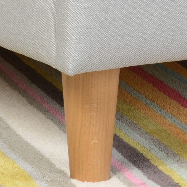 Tapered, solid beech feet gently lift the large frame from the ground.