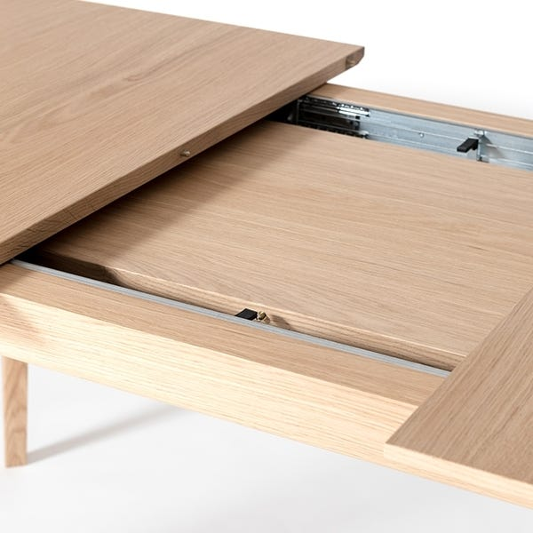 Leaves are hidden inside the table and easily and smoothly be put into place within seconds.