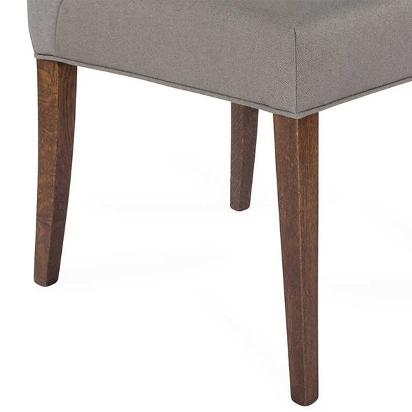 Solid oak legs create a sturdy base for the chair.